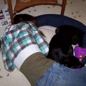 Me sleeping with Willow on her doggy bed. XD