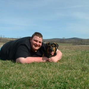 Dan and Flash laying around on the farm. Easter 4/04/10